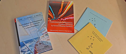 Books on a table (published by Prof. Dr. Alfio Borzi)