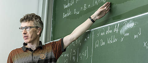 Professor Kanzow in front of a blackboard