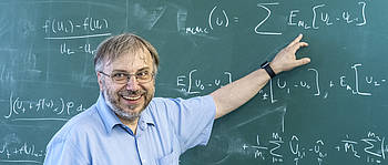 Prof. Dr. Christian Klingenberg in front of a blackboard
