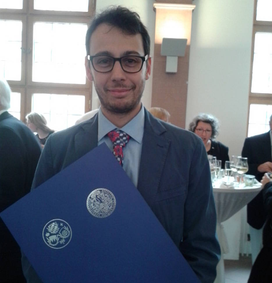 "Dr. Gabriele Ciaramella with document ""Promotion Award 2016"""