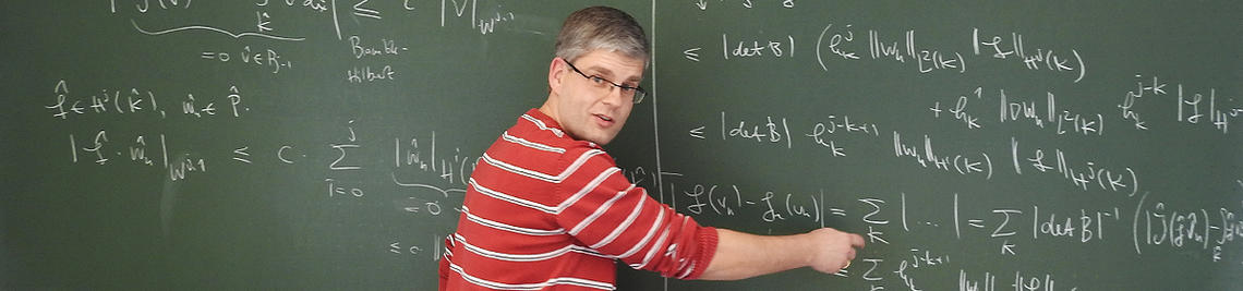 Professor Wachsmuth is writing on a blackboard