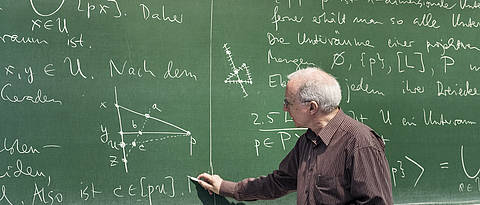 Professor Grundhöfer in front of a blackboard